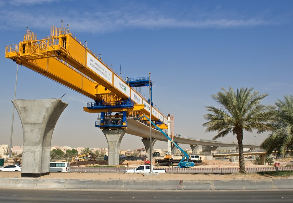 Manlift Boom AWP working on Riyadh Metro Line with Bridging Unit near Station